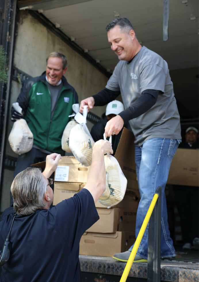 Noble McIntyre unloading turkeys at annual day of kindness